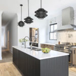 top interior designer designs modern kitchen with wooden cabinets, wood flooring, and stainless steel appliances
