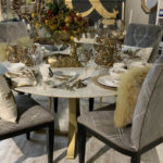 dining room table set with gold and white glassware