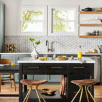top interior designer designs a modern kitchen with colorful cabinets, and gold accents