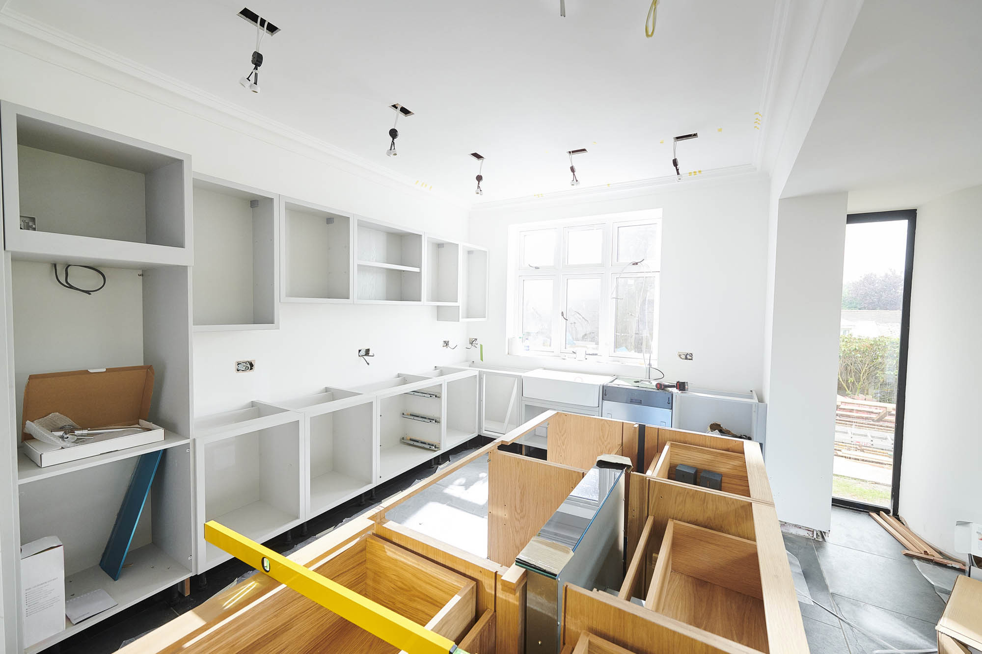 a modern kitchen partially finished, designed by a top interior designer